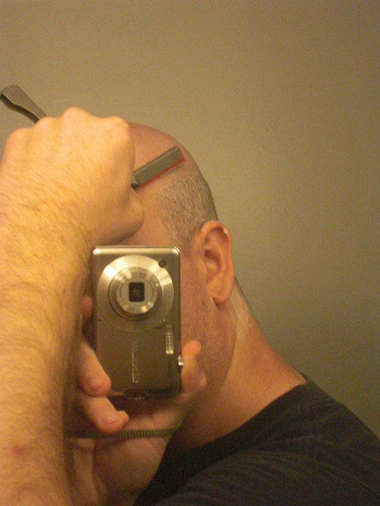 Picture showing me shaving side of head with shavette