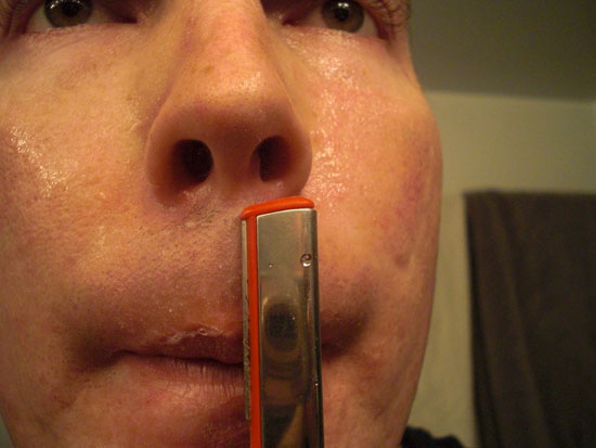 Shaving hard to reach hairs below nose