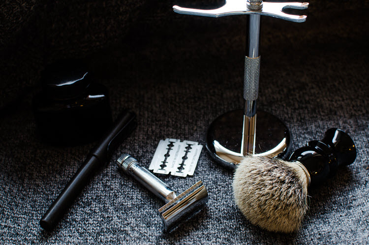 An image of a safety razor, brush, and stand