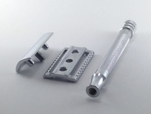 An image of a Merkur 180 Long Handle razor disassembled