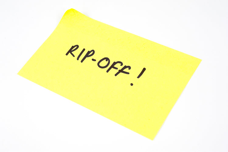 "A picture of a yellow sticky note with the ""RIP-OFF!"" written on it."