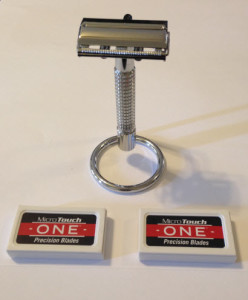MicroTouch One razor hanging on stand with razor blade boxes in front