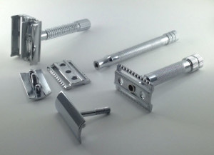 Three safety razors disassembled
