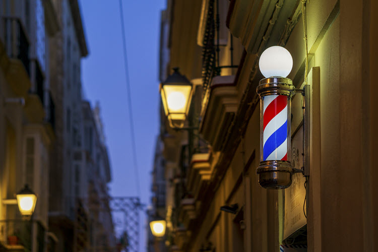 Barbershop Light Sign at Night with Blurred Street Lights Cadiz Andalusia Spain